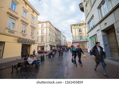 Lviv, Ukraine - October 18, 2015: Citizens and tourists on a city street at the weekend
