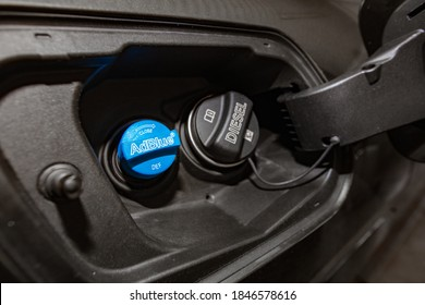 Lviv, Ukraine - October 21, 2020: Closeup of Filler neck for Diesel exhaust fluid AdBlue