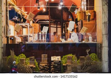 Lviv, Ukraine - october 22, 2016: Lviv workshop of chocolate. Cook preparing chocolate pastry
