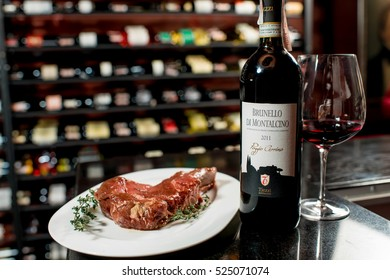 Lviv, Ukraine - October 25, 2016: Meat steak with red italian Brunello di Montalcino wine on the table in the restaurant