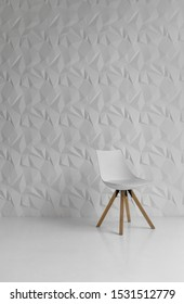 Lviv, Ukraine – October 3: White chair in white room with decorated wall on 03/10/2019 in Lviv