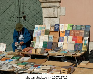 LVIV, UKRAINE - OCTOBER 4, 2014: Book flea market near the monument of Ivan Fyodorov. Man selling his books and looking at second hand book on 4 October 2014, Lviv, Ukraine.