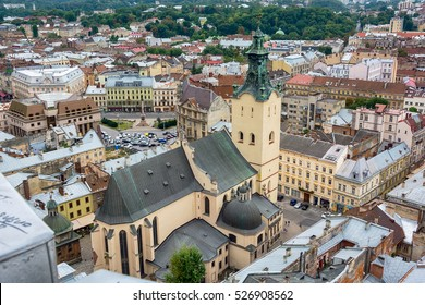 Lviv, Ukraine old city vintage toned top view panorama with houses roofs and Latin Cathedral