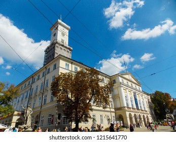 LVIV, UKRAINE - SEPT 02, 2016: Lviv City Hall is located in the middle of Rynok Square, is a replica of original Viennese Classicist style town hall. The 65m high tower gives amazing aerial city view.