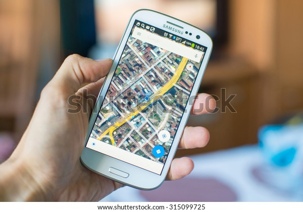 LVIV, UKRAINE - Sept 09, 2015: Hand holding white Samsung Smart Phone with Google map application