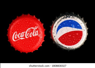 LVIV, UKRAINE - September 03, 2020: Coca cola and Pepsi bottle caps
