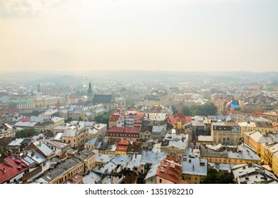 Lviv, Ukraine- September 1, 2018: Foggy Morning of the City Center from Town Hall Tower. Tiled Roofs of the Old City