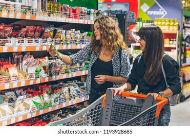 LVIV, UKRAINE - September 8, 2018: two women choosing products in grocery store