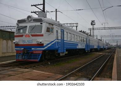 LVIV, UKRAINE.January 2021. Ukrainian passengers are waiting train moving on Lviv Railway Station, Ukraine.