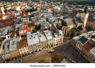 LVOV, UKRAINE - AUG 8: Top view from Lviv City Hall - building city administration of the city currently open the view point for tourists, Aug 8, 2012 in Lvov, Ukraine. Tower was built in 1827-1835.