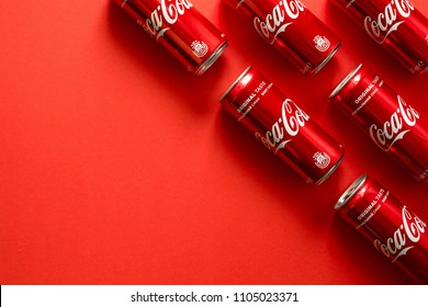 Lvov, Ukraine - January 23, 2018. Close-up of Coca Cola drink jars lying on paper background.  Texture. Top view