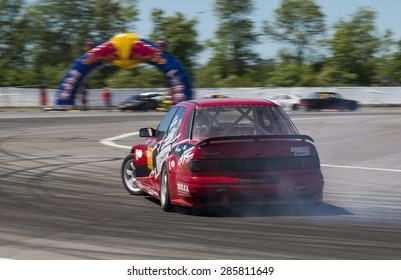 Lvov, Ukraine - June 6, 2015: Unknown rider on the car brand Nissan overcomes the track in the championship of Ukraine drifting in Lvov, Ukraine.