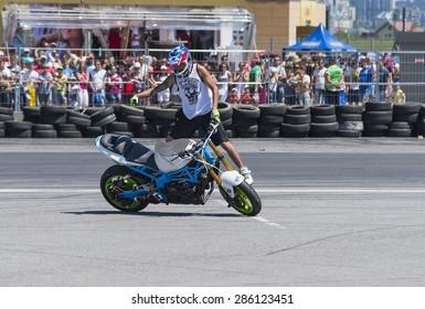 Lvov, Ukraine - June 6, 2015: Unknown stunt bikers entertain the audience before the start of the championship of Ukraine drifting in Lvov, Ukraine.