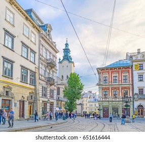 LVOV, UKRAINE - MAY 16, 2017: The corner of the Market Square (Ploshcha Rynok) with the bell tower of Latin Cathedral on background, on May 16 in Lvov.