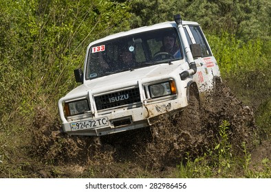Lvov, Ukraine - May 30, 2015: Off-road vehicle ISUZU (No. 133) overcomes the track on  of   landfill near the city  Lvov, Ukraine.