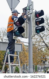LVOV, UKRAINE - OCTOBER 16: Technical workers in the heart of the city will replace the updated traffic lights on the latest LED on October 16, 2013 in Lviv, Ukraine.