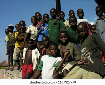 Lwizi, Katanga, Democratic Republic of the Congo, June 6th 2006:  Children pose at an abandoned train station