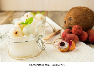 Lychee dessert with Tapioca pearls and Coconut on wooden background