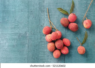 Lychee on a wooden background. Top view