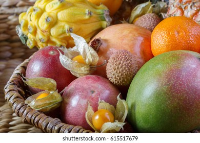 Lychee, pomegranate, mango. Exotic fruits in a basket.