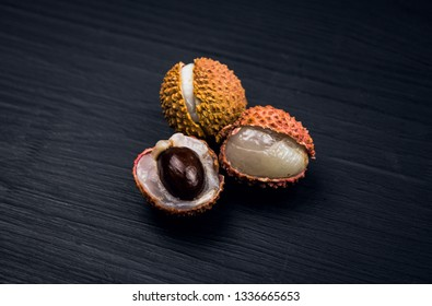 Lychees fruits on wooden background