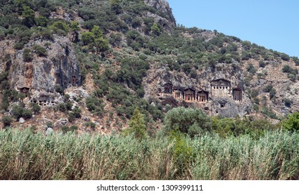Lycian rock cut tombs of Kaunos (Dalyan). Dalyan is a town in Muğla Province located between the well-known districts of Marmaris and Fethiye on the south-west coast of Turkey.