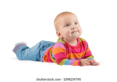 lying baby in jeans looks up