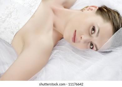 lying beauty bride in white dress