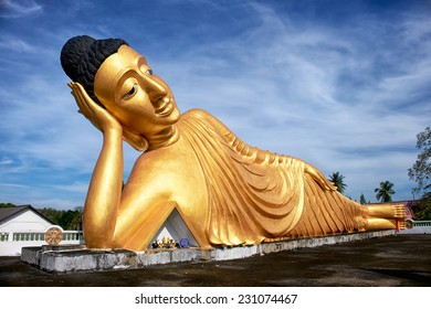 Lying Buddha statue in Wat Sri Sunthon temple on Phuket in Thailand