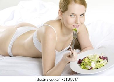 lying down woman eating salad