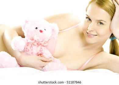 lying down woman wearing underwear with teddy bear