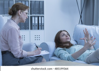 Lying female patient talking about her problems with the psychiatrist