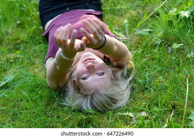 lying girl stretches her hands