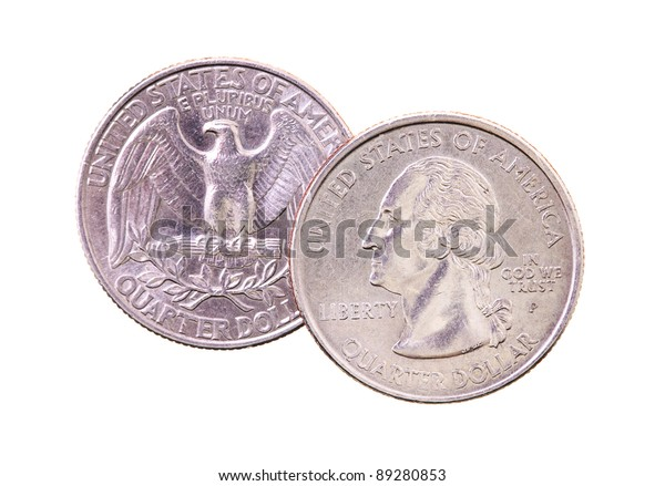 Lying one on another the American coins on twenty five cents (it is isolated on white, focus on the top coin)