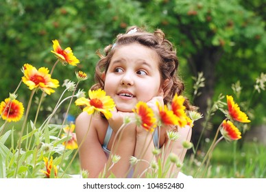 Lying  pretty little girl on green meadow with yellow flowers