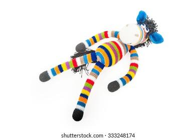 Lying toy zebra on white background, isolated