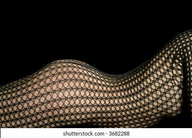 a lying woman in a black net stocking