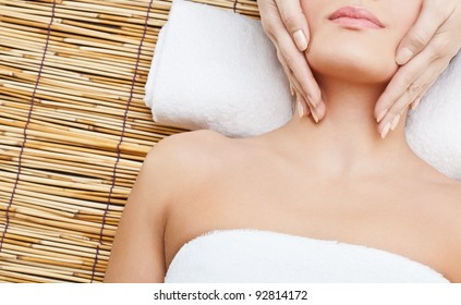 lying woman massaging her neck