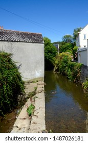 LYME REGIS, DORSET, ENGLAND - AUGUST 17, 2014: Banksy's origami crane with goldfish at the side of the River Lim.