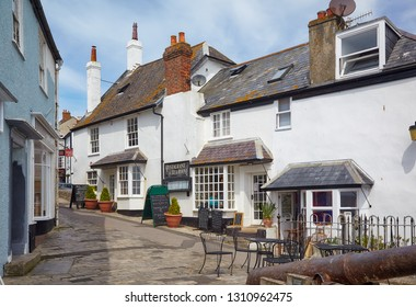 LYME REGIS, ENGLAND - MAY 12, 2009: The cozy white house of Bell cliff restaurant on the small street of the coastal town of Lyme Regis. West Dorset. England