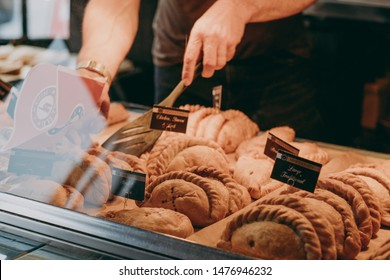 Lymington, UK - July 14, 2019: Cornish pasties on sale at a Mines A Pasty shop in Lymington, UK. Cornish pasty is a traditional British food particularly associated with Cornwall and Devon.