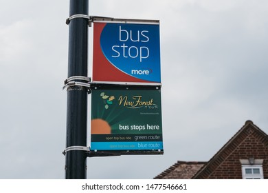 Lymington, UK - July 14, 2019: Bus stop an New Forest Tour stop on a street in Lymington, New Forest, a historic coastal town with an ancient seaport and a rich maritime history.