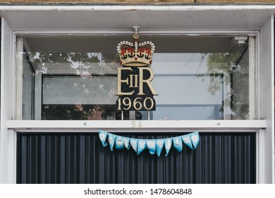 Lymington, UK - July 14, 2019:1960 Royal cypher of HM the Queen Elizabeth II (EIIR) on a building in Lymington, New Forest. Queen Elizabeth II is the longest-lived and longest-reigning British monarch
