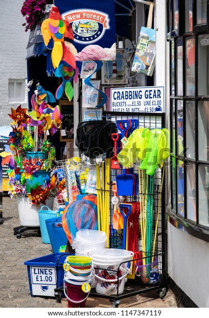 Lymington, United Kingdom - July 22 2018:  A typical British sea side gift shop, with childrens fishing nets, windmills, spades and buckets on sale.