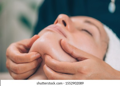 Lymphatic drainage face massage with wooden massager