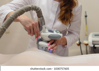 Lymphatic drainage massage LPG apparatus process. Woman in white suit getting anti cellulite massage in a beauty SPA salon. LPG, and body contouring treatment in clinic. Massage procedure. Body care
