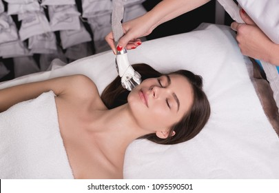 Lymphatic drainage massage LPG apparatus process. Therapist beautician makes a rejuvenating facial massage for the woman in a SPA salon. Beauty and bodycare concept.
