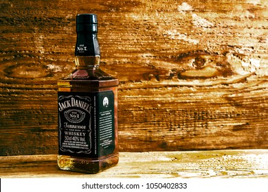 LYNCHBURG, TENNESSEE USA - NOVEMBER 14, 2016: Jack Daniels stand on wooden table. Jack Daniel's, a brand of the best selling American whiskey in the world, produced by the Brown-Forman Corporation