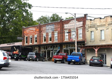Lynchburg, TN, USA - September 23, 2019:  Drug store, Lynchburg Hardware and General Store, Jack Daniels and Barrel shop in the traditional commercial block close to the Jack Daniels Distillery.