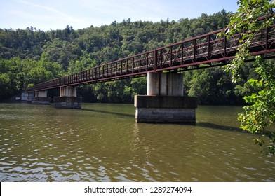 Lynchburg, Virginia / USA - August 25, 2016: A foot bridge over the James River along the Appalachian Trail.